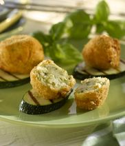 Fried cream cheese-balls on grilled zucchini-slices
