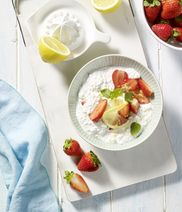 Coconut rice pudding with marinate strawberries